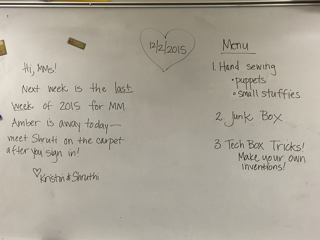 Photo of whiteboard showing a message to the students from mentors and a list of the week's activities