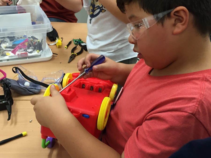 Photo of boy taking toy apart